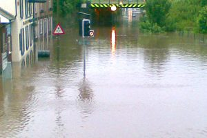 Road and buildings submerged under flood water