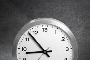 Silver Framed 13 Hour Clock Reprenseting Overtime