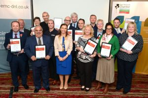 Group of business owners with certificates celebrating long Chamber memberships
