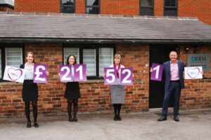 Members of BRM Solicitors Wills and Probate Team holding numbers showing the total raised for the 2020 Ashgate Hospicecare Free Wills Month