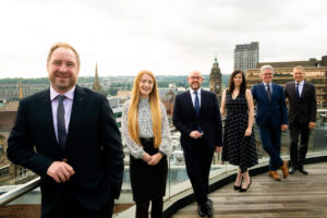 BRM's Dispute Resolution Team Pictured With a Panorama of Sheffield City Centre Behind Them.